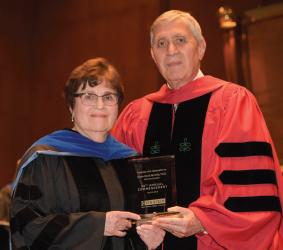 Commencement speaker Susan Band Horwitz, Ph.D., and Dean Allen M. Spiegel, M.D.